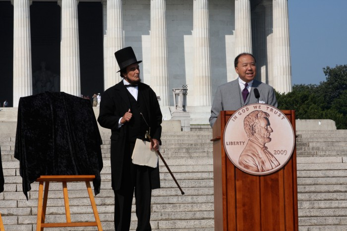 With President Abraham Lincoln, I am delivering remarks before unveiling the four new penny designs to celebrate the Lincoln bicentennial in 2009.