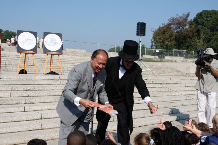 Myself and Honest Abe doing what politicians do best…giving away money (at least its only a penny to each child).