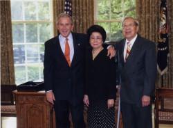 President George W. Bush, my mom Rosa Moy, and my dad Tom Moy.