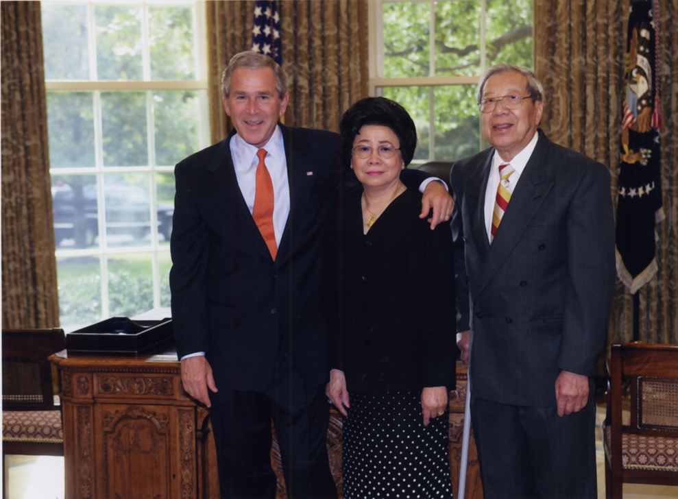 President George W. Bush, my mom Rosa Moy, and my dad Tom Moy.