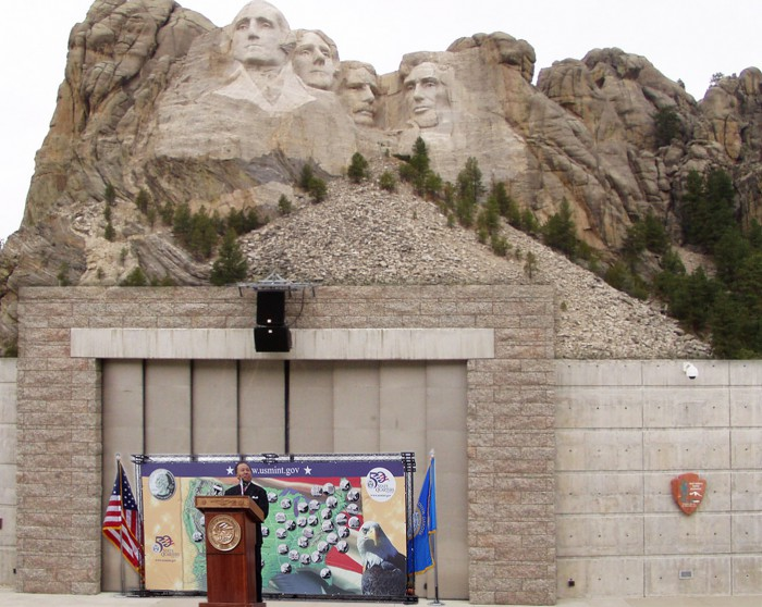 Sharing remarks at the Mount Rushmore Amphitheater under the watchful eyes of Presidents Washington, Jefferson, Roosevelt, and Lincoln.