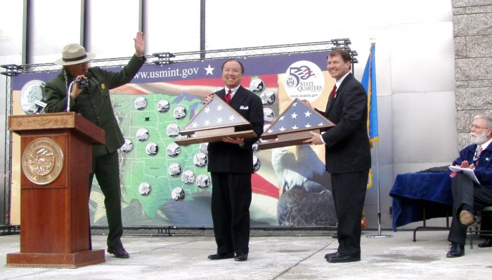 Mount Rushmore National Memorial Superintendent Gerard Baker presents Gov. Mike Rounds and myself with American flags flown over Mount Rushmore. Rapid City Mayor and master of ceremonies Jim Shaw looks on.